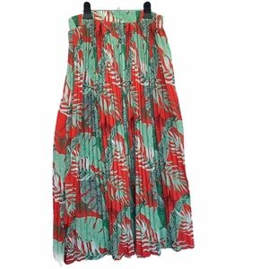 Red skirt with green palm leaf pattern